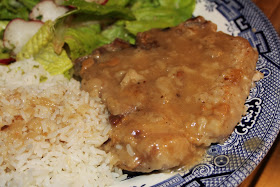 Smothered pork chops with rice and gravy